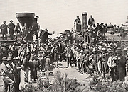 Driving in the golden rivet (spike) connecting the Atlantic and Pacific oceans by railway: Promontory, Utah, 10 May 1869. Union Pacific Railroad.