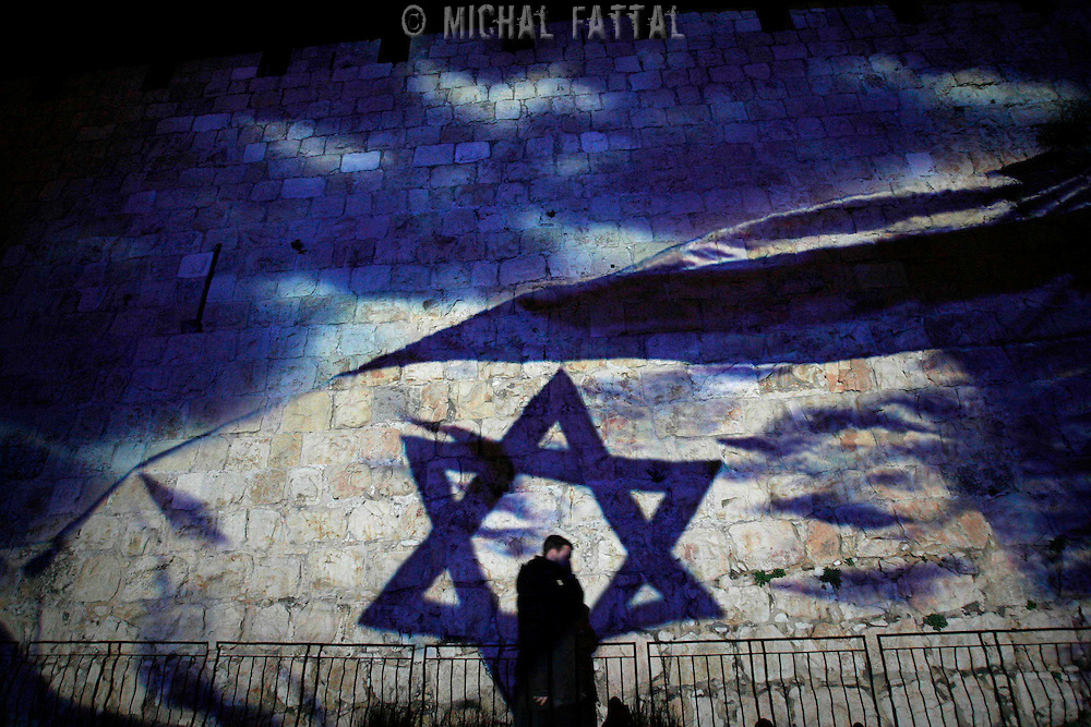 Israeli ultra orthodox walks in front of the Old City wall that displayed image projections during a test for the upcoming Passover holidays on 27 February in Jerusalem. Photo by Michal Fattal/FLASH90 *** Local Caption *** ??? ?????........???????........????........?????........????........?????....???? ???? ??? ????? ???? ?????? ???????? ???? ????? ??????? ?? ??????.