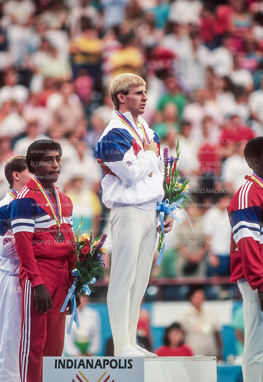 INDIANAPOLIS, IN - AUGUST 1987:  Scott Johnson of  the USA participates in the awards ceremony after winning the Men's All Around title of the 1987 Pan Am Games men's gymnastics competition in August 1987 at the Hoosier Dome in Indianapolis, Indiana.  (Photo by David Madison/Getty Images)