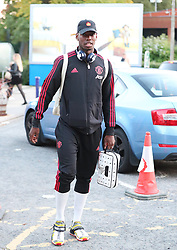 Manchester United's Paul Pogba gets off the train at Wilmslow Station after their defeat to West Ham United