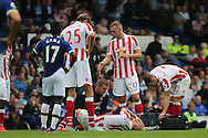 Marko Arnautovic of Stoke City receives treatment on the pitch after an injury. Premier league match, Everton v Stoke city at Goodison Park in Liverpool, Merseyside on Saturday 27th August 2016.<br /> pic by Chris Stading, Andrew Orchard sports photography.