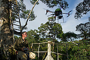 Scientist Shawn McCracken flying his Octocopter used for canopy research.<br /> Yasuni National Park, Amazon Rainforest<br /> ECUADOR. South America