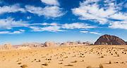 A jeep overlooks the desert and sandstone cliffs of Wadi Rum, Jordan.