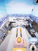 Ski dump: Toilets with 360-degree views from the piste wrapped around them so you can imagine you're about to fly off the slopes<br /> <br /> For those on the hunt for the more daring bathroom experience, this ski-jump toilet may be one to tick off the list, but you would have to travel to Asia.<br /> This Japanese toilet wraps the visitor in a 360 view of a steep ski jump slope with the snowy piste and the mountain range at the horizon on its walls.<br /> The visitor can strap in to a pair of skis on the floor to get the real feel of a skier prepared for the big jump.<br /> During the campaign for a Coca Cola coffee drink multiple Japanese ski resorts had their toilets done up to resemble the slopes outside.<br /> The branded toilet holder carries the message which, directly translated into English, reads: 'Seriously kick-ass intensely sweet for the real coffee super zinging unstoppable Max! Taste Explosion!'<br /> Georgia Max Coffee is an Asian canned coffee drink popular in Japan and Singapore.<br /> ©Coca Cola/Exclusivepix Media
