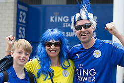 © Licensed to London News Pictures. 07/05/2016. Leicester, UK. Leicester City fans celebrating outside the King Power stadium before their match with Everton before lifting the Premiership trophy. Pictured, a family enjoying the special day. Photo credit: Dave Warren/LNP