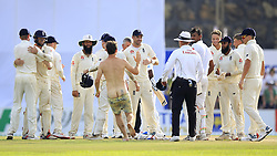 November 9, 2018 - Galle, Sri Lanka - A streaker invades the playing area as England cricketers led by captain Joe Root celebrate their victory over the Sri Lankan cricket team during the 4th day's play of the first test cricket match between Sri Lanka and England at Galle International cricket stadium, Galle, Sri Lanka. 11-09-2018  (Credit Image: © Tharaka Basnayaka/NurPhoto via ZUMA Press)