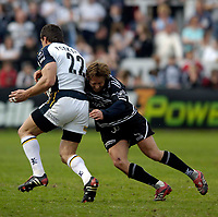 Photo: Jed Wee.<br />Newcastle Falcons v Leeds Tykes. Guinness Premiership. 06/05/2006.<br /><br />Newcastle's Jonny Wilkinson (R) tackles Leeds' Andre Snyman.