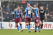 Scott Laird of Scunthorpe United,Kevin van Veen of Scunthorpe United and Stephen Dawson of Scunthorpe United celebrate going 1-0 up from Luke Williams of Scunthorpe United scoring during the Sky Bet League 1 match between Scunthorpe United and Wigan Athletic at Glanford Park, Scunthorpe, England on 2 January 2016. Photo by Ian Lyall.