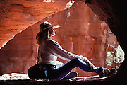 Relaxing and meditating in the shade of a sandstone arch.  Yoga/Meditation classes with Global Fitness Adventures Health Spa, Sedona, Arizona..