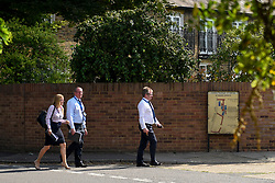 © Licensed to London News Pictures. 25/08/2019. SOUTHALL, UK. Detectives in St Mary's Avenue near Southall in west London.  It is reported that a man in his 60s was stabbed outside The Plough pub on Tentelow Avenue in the early evening of 24 August and stumbled to nearby St Mary's Avenue to seek aid from a residence.  Police were called at 6.41pm, paramedics and air ambulance crews attended but the man passed away.  A man in his 30s has been arrested on suspicion of murder.  The investigation continues. Photo credit: Stephen Chung/LNP