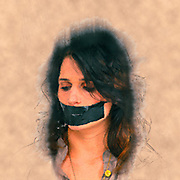 Digitally enhanced image of a young woman with her mouth taped close