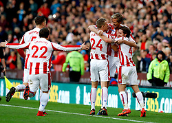 Stoke City's Peter Crouch (second right) celebrates scoring his side's second goal of the game