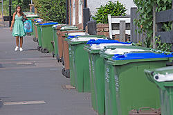 © Licensed to London News Pictures 29/07/2021. Bexley, UK. Wheelie bins full of waste are lining the streets in Bexley. Household waste continues to pile up in the London borough of Bexley as binmen announce new strike dates in August. The workers have already been on strike for weeks and are striking over pay and victimisation of staff but employer Serco has failed to enter into negotiations. Photo credit:Grant Falvey/LNP