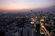 Downtown Bangkok and Sathorn Road at dusk seen from Banyan Tree Hotel's Vertigo Grill & Moon Bar on the 61st floor.