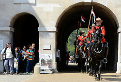 © Licensed to London News Pictures. 23/05/2012. London, UK The Guard comes through Horse Guards. Canadian Mounties Guard Her Majesty the Queen at Horse Guards Parade on Whitehall in Westminster. They will guard on all day and will be the first non-British force to guard the Queen. Photo credit : Stephen Simpson/LNP