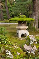 A moss hat on a traditional stone lantern in the Kenrokuen Garden, Kanazawa, Ishigawa, Japan