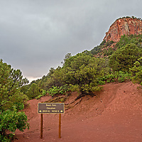 The west summit of Bears Ears Buttes rises above cedar forests in Bears Ears National Monument, Utah.