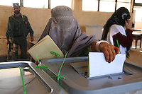 A woman in Helmand's capital Lashkar Gah casts her vote in the presidential elections.