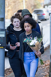 © Licensed to London News Pictures. 26/11/2017. Leeds, UK. People arrive at the scene in Leeds with flowers where a crash occurred involving a stolen car. Police say five people have been killed after a stolen car crashed into a tree on Saturday night. Two of the dead are 15 year old boys. The other is aged 12. Two fifteen year olds are in custody.  Photo credit: Andrew McCaren/LNP