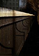 Iron railings illuminated by the low sun, London, UK