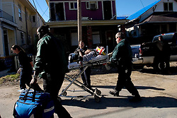 21Dec 05. New Orleans, Louisiana. Post Katrina aftermath. <br /> A roofing contractor falls from a roof in Uptown New Orleans. Paramedics soon on the scene take the injured man to hospital. <br /> Photo; ©Charlie Varley/varleypix.com