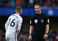 Football - 2019 / 2020 Premier League - Chelsea vs. Sheffield United<br /> <br /> Referee Stuart Attwell in conversation with Sheffield United's Ollie Norwood, at Stamford Bridge.<br /> <br /> COLORSPORT/ASHLEY WESTERN