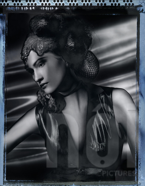 Old black and white Polariod of a model wearing 1920's style clothing for a fashion shoot with the use of lightpainting, Hanoi, Vietnam, Southeast Asia