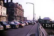 Cars parked on the front by Halfpenny pier, Pier Hotel, former Great Eastern Hotel at Harwich, Essex, England 1970