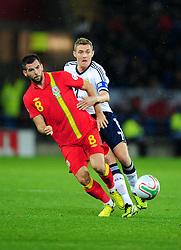 Scotland's Darren Fletcher (Manchester United) battles for the ball with Wales Joe Ledley (Celtic) - Photo mandatory by-line: Joe Meredith/JMP  - Tel: Mobile:07966 386802 12/10/2012 - Wales v Scotland - SPORT - FOOTBALL - World Cup Qualifier -  Cardiff   - Cardiff City Stadium -
