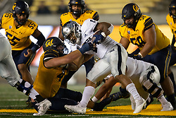 Nevada running back Devonte Lee (2) is dragged down by California defensive end JH Tevis (47) during the fourth quarter of an NCAA college football game, Saturday, Sept. 4, 2021, in Berkeley, Calif. (AP Photo/D. Ross Cameron)