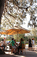 Diners enjoy a lunch at a sidewalk cafe along Park Ave. in downtown Winter Park, Florida.