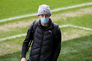 AFC Wimbledon midfielder Callum Reilly (33) arriving for the game wearing face mask during the EFL Sky Bet League 1 match between AFC Wimbledon and Milton Keynes Dons at Plough Lane, London, United Kingdom on 30 January 2021.