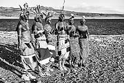 Samburu Morani dancing on a hilltop at Lake Turkana,black and white, Lake Turkana, Loiyangalani,Kenya, Africa