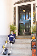 Halloween items at front door of a home in the Beacon Hill historic district of the city of Boston, Massachusetts, USA
