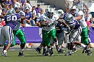 Marshall running back Ahmad Bradshaw (44) brakes up the middle against Kansas State at Bill Snyder Family Stadium in Manhattan, Kansas, September 16, 2006.  The Wildcats beat the Thundering Herd 23-7.