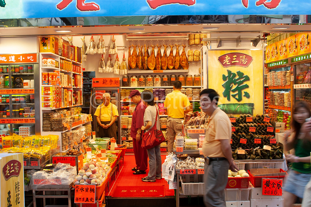 Grocery store in Wan Chai area on the thronging market market street of Bowrington Road in Hong Kong, China. The shop sells fruit, cured meats, groceries etc. A general store for many foods.