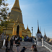 Tourists near Phra Si Rattana Chedi in the Emerald Budda Temple, Bangkok, Thailand