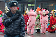 Moscow, Russia, 21/03/2010..A policeman watches revellers as several thousand people attend the 19th annual Moscow St Patrick's Day parade.