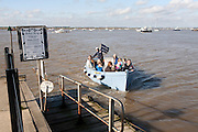 Small ferry boat crossing River Deben between Felixstowe Ferry and Bawdsey Quay, Suffolk, England, UK