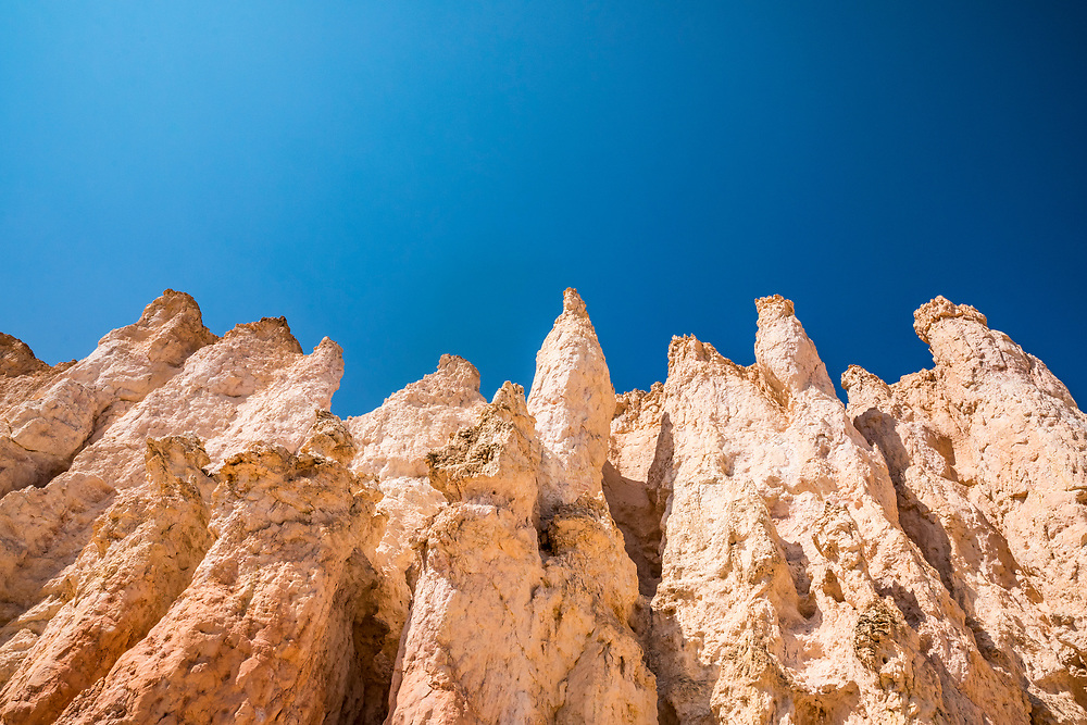 Blue Sky and rock stuctures called hoodoos in Bryce Canyon National Park, Utah, USA.