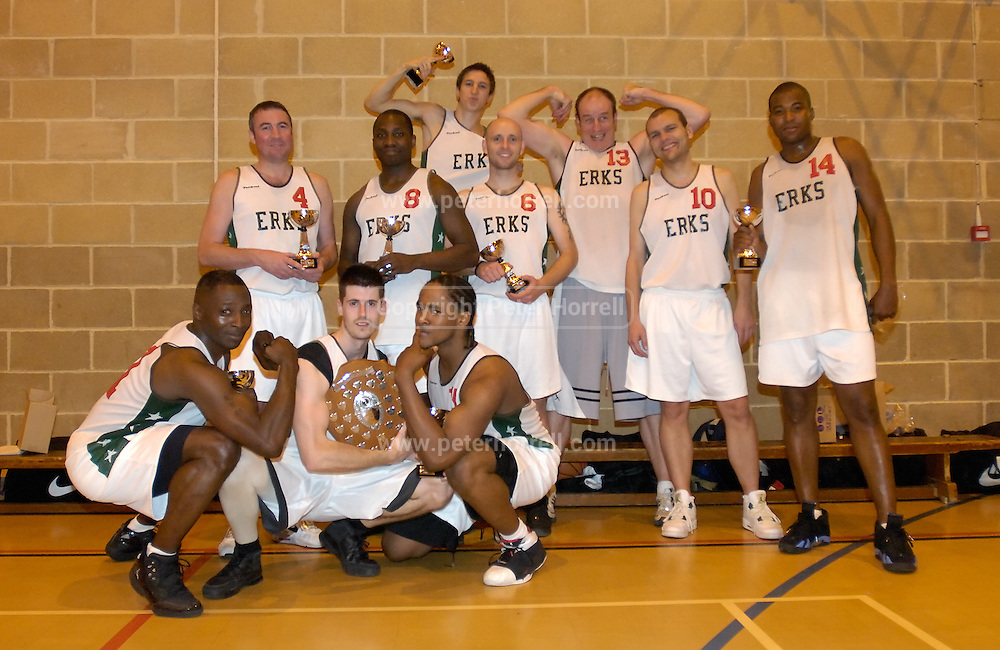 DAGENHAM - MAY 17: Barking and Dagenham Erkenwald Basketball Club strike a pose after beating Cardinals 81 - 68 in the Essex Metropolitan Basketball League Play Off final at Sydney Russell School. From left: Keith Pringle, Declan McCusker (#4), Mark Denchfield (holding shield), Martin Overare (#8), Craig Pringle, Robin French (holding cup),  Gareth Sims (#6), Dave Churches (#13), Lee Atkinson (#10),  L. Daley (#14).