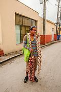 Santa Clara, Cuba man selling garlic
