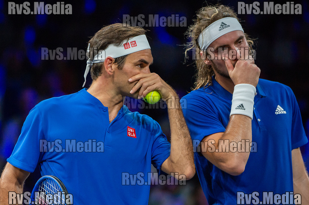 GENEVA, SWITZERLAND - SEPTEMBER 22: Roger Federer of Team Europe talks strategy serve with Stefanos Tsitsipas during Day 3 of the Laver Cup 2019 at Palexpo on September 20, 2019 in Geneva, Switzerland. The Laver Cup will see six players from the rest of the World competing against their counterparts from Europe. Team World is captained by John McEnroe and Team Europe is captained by Bjorn Borg. The tournament runs from September 20-22. (Photo by Robert Hradil/RvS.Media)