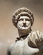 Roman statue of Emperor Hadrian .Marble. Perge. 2nd century AD. Inv no 3861-3863 .Antalya Archaeology Museum; Turkey. Against a warm art background. .<br /> <br /> If you prefer to buy from our ALAMY STOCK LIBRARY page at https://www.alamy.com/portfolio/paul-williams-funkystock/greco-roman-sculptures.html . Type -    Antalya     - into LOWER SEARCH WITHIN GALLERY box - Refine search by adding a subject, place, background colour, museum etc.<br /> <br /> Visit our ROMAN WORLD PHOTO COLLECTIONS for more photos to download or buy as wall art prints https://funkystock.photoshelter.com/gallery-collection/The-Romans-Art-Artefacts-Antiquities-Historic-Sites-Pictures-Images/C0000r2uLJJo9_s0