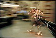 Moving like its skittish biological counterpart, Spring Flamingo walks tethered to a boom in a circular course around its home at the MIT Leg Lab, Cambridge, MA. From the book Robo sapiens: Evolution of a New Species, page 8-9.