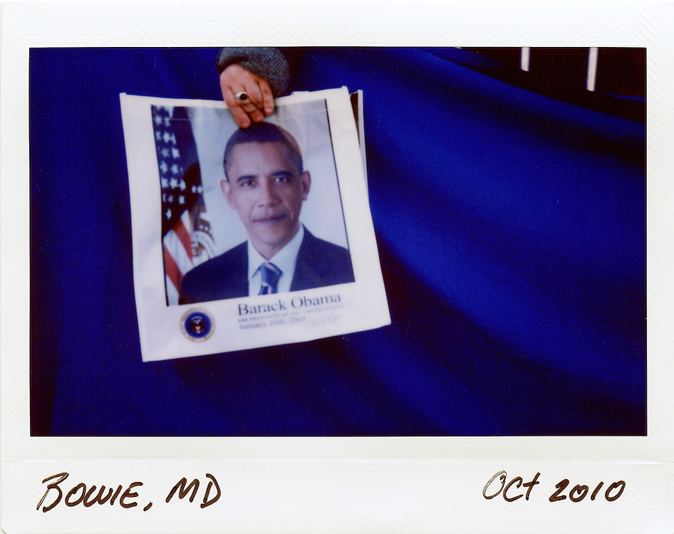 A supporter of U.S. President Barack Obama is seen behind a barricade at a rally for Governor Martin O'Malley at Bowie State University in Bowie, Maryland, October 7, 2010.
