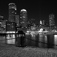 Boston Black and white photography of the famous Boston Harbor skyline as seen from Fan Pier, part of the Harbor Walk. This historic and iconic New England city of Boston night scenery photography image is available as museum quality photography prints, canvas prints, acrylic prints or metal prints. Fine art prints may be framed and matted to the individual liking and decorating needs:<br /> <br /> http://juergen-roth.pixels.com/featured/boston-one-international-office-building-juergen-roth.html<br /> <br /> Good light and happy photo making! <br /> <br /> My best, <br /> <br /> Juergen<br /> Website: www.RothGalleries.com<br /> Twitter: @NatureFineArt<br /> Facebook: https://www.facebook.com/naturefineart<br /> Instagram: https://www.instagram.com/rothgalleries<br /> Photo Blog: http://whereintheworldisjuergen.blogspot.com