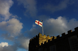 (C) Licensed to London News Pictures. 23/04/2016<br /> Whitby, UK<br /> <br /> The flag of St George flies over Saint Mary's church on St George's Day as early morning sun shines down on the North Yorkshire coastal town of Whitby. <br /> <br /> Photo Credit: Ian Forsyth/LNP