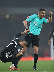 02 December 2017 London : Premier League Football : Arsenal v Manchester United - referee Andre Marriner helps up Marcos Rojo of United as he was feigning injury.<br /> (photo by Mark Leech)