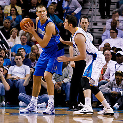 November 17, 2010; New Orleans, LA, USA; Dallas Mavericks power forward Dirk Nowitzki (41) of Germany is guarded by New Orleans Hornets power forward Jason Smith (14) during a game at the New Orleans Arena. The Hornets defeated the Mavericks 99-97. Mandatory Credit: Derick E. Hingle